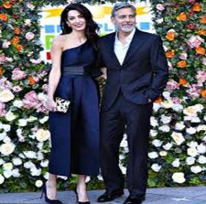 George Clooney e Amal Alamuddin splendono anche al gala di Edimburgo: i due sorridenti e innamorati